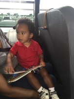 Tiger reading his new Thomas the Tank Engine book with Big Shirley (purchased at the gift shop tent) on the shuttle ride back to the car